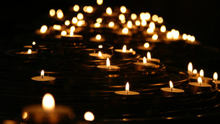 Image of tea light candles against a dark background