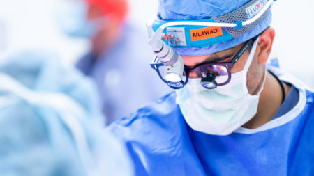 photo of surgeon in scrubs during a heart surgery at uva