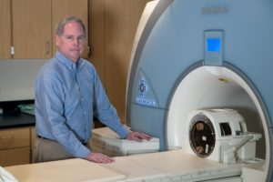 Photo: Biomedical engineer John Mugler, who pioneered new technologies that improved MRI imaging, has been named to the National Academy of Inventors. (Photo by Dan Addison, University Communications)