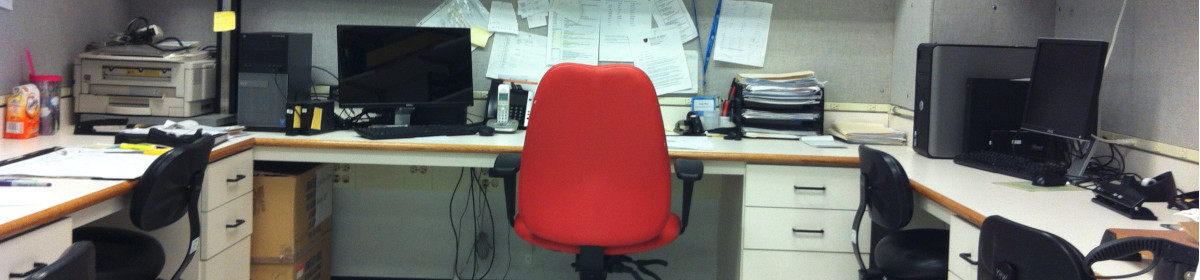 Banner image of an empty red chair at a desk